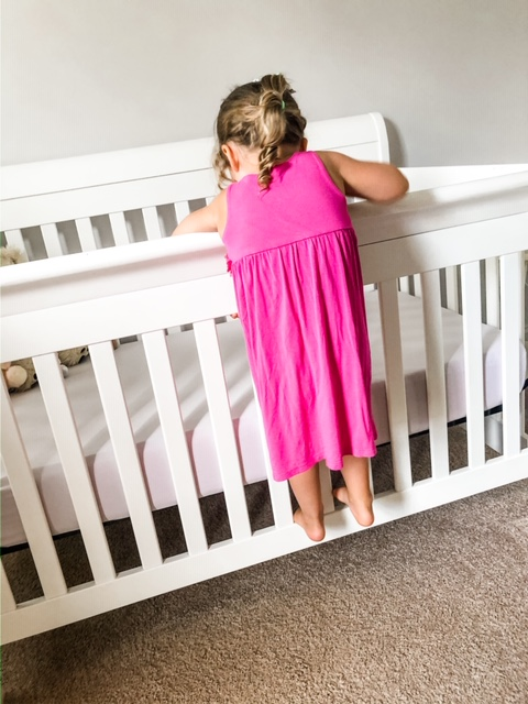 toddler and baby crib