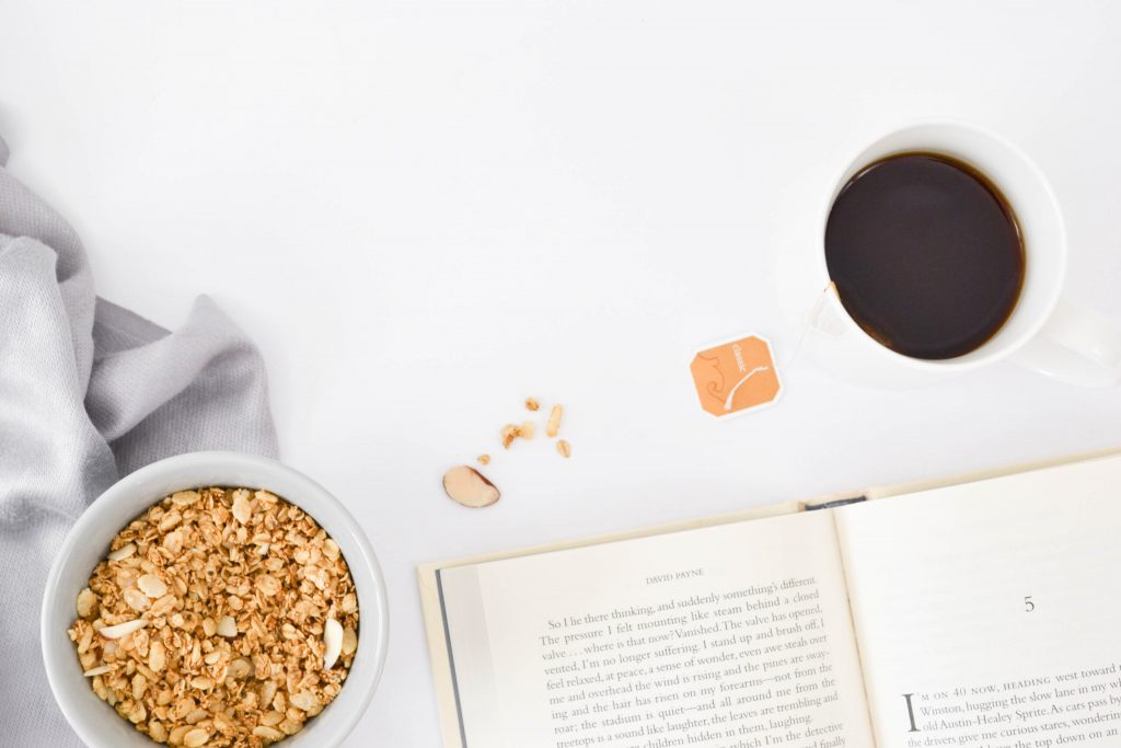 start a journal for self care with cup of coffee and bowl of cereal