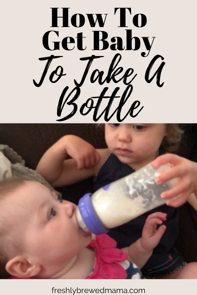 how to get baby to take a bottle image featuring toddler giving baby a bottle full of formula.