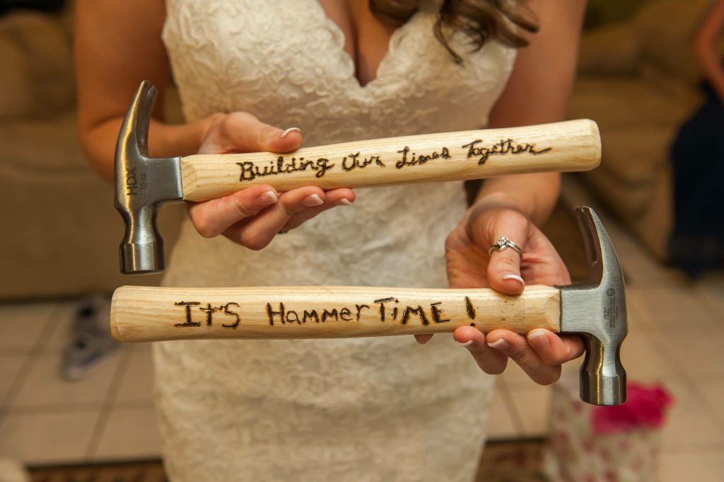 bride holding up bridal gift from husband