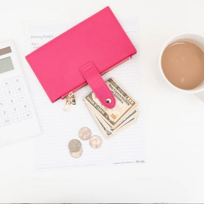 wallet with money symbolizing working moms earning income